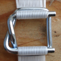Galvanized buckle for composite strapping